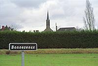 A sign indicating the wine village Bonnezeaux with the village church in the background, Bonnezeaux Maine et Loire France