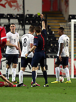 Pictured: Match referee Artyom Kuchin shows James Ward-Prowse of England (8) a yellow card. Monday 19 May 2014<br />
