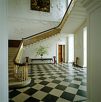 The impressive entrance hall and staircase at Castletown with its black and white marble floor and ornamental plasterwork