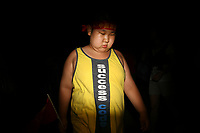 CHINA. Beijing. An overweight boy near the Olympic village during the Beijing 2008 Summer Olympics. 2008