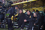 Norwich City 1 Manchester United 0, 17/11/2012. Carrow Road, Premier League. Manchester United manager Sir Alex Ferguson (seated) is greeted by rival Chris Hughton in the dugout at Carrow Road stadium, home of Norwich City shortly before kick-off in a Barclays Premier League fixture. The home team won the match by one goal to nil watched by a crowd of 26,840. It was Norwich City's first victory against Manchester United since 2005. Photo by Colin McPherson.