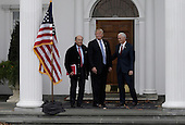 United States President-elect Donald Trump (C) and Vice President-elect Mike Pence (R) pose with investor  Wilbur Ross (L) at the clubhouse of Trump International Golf Club, in Bedminster Township, New Jersey, USA, 20 November 2016.<br /> Credit: Peter Foley / Pool via CNP