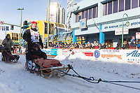 Aaron Burmeister and team leave the ceremonial start line with an Iditarider at 4th Avenue and D street in downtown Anchorage, Alaska on Saturday March 2nd during the 2019 Iditarod race. Photo by Brendan Smith/SchultzPhoto.com
