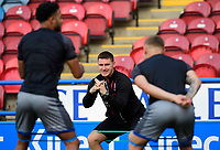 Lincoln City's head of sports science Luke Jelly, centre, with Lincoln City's Bruno Andrade, left, and Lincoln City's Harry Anderson during the pre-match warm-up<br /> <br /> Photographer Chris Vaughan/CameraSport<br /> <br /> The Carabao Cup First Round - Huddersfield Town v Lincoln City - Tuesday 13th August 2019 - John Smith's Stadium - Huddersfield<br />  <br /> World Copyright © 2019 CameraSport. All rights reserved. 43 Linden Ave. Countesthorpe. Leicester. England. LE8 5PG - Tel: +44 (0) 116 277 4147 - admin@camerasport.com - www.camerasport.com