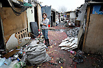 Skurta Hodici, 17, cleans up around her home in the wake of a severe winter storm in February 2012. She lived in an illegal Roma settlement in Belgrade, Serbia. The families that lived here, most of whom survive from recycling cardboard and other materials, were forcibly evicted in April 2012. Many including Hodici were moved into metal shipping containers on the edge of Belgrade.