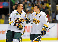 16 November 2008: University of Vermont Catamount forward Corey Carlson (left), a Senior from Two Harbors, MN, smiles to forward and Team Captain Dean Strong (right), a Senior from Mississauga, Ontario prior to facing the visiting Merrimack College Warriors at Gutterson Fieldhouse, in Burlington, Vermont. The Catamounts defeated the Warriors 2-1 in front of a near-capacity crowd of 3,813...Mandatory Photo Credit: Ed Wolfstein Photo