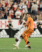 FOXBOROUGH, MA - JUNE 29: Juan Fernando Caicedo #9 attempts to control the ball as Alejandro Fuenmayor #2 defends during a game between Houston Dynamo and New England Revolution at Gillette Stadium on June 29, 2019 in Foxborough, Massachusetts.