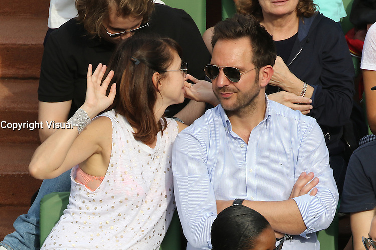 Delphine McCarty and Christophe Michalak seen watching tennis during Roland Garros tennis open 2016 on may 28 2016.