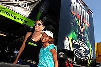 Sept. 25, 2011; Ennis, TX, USA: NHRA funny car driver Alexis DeJoria signs autographs during the Fall Nationals at the Texas Motorplex. Mandatory Credit: Mark J. Rebilas-