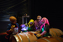 China - Ningxia - Local women manually transfering wine into the oak barrels. With more than 1,200 hectares of vines, Pigeon Hill is one of the biggest wineries in the region. Thanks to its total tank capacity of 6,000 tons, it can produce up to five million bottles per year<br />