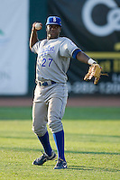 Left fielder Luis Del Rosario #27 of the Burlington Royals throws the ball back to the infield at Howard Johnson Stadium June 27, 2009 in Johnson City, Tennessee. (Photo by Brian Westerholt / Four Seam Images)