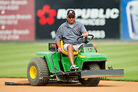 Kannapolis Intimidators head grounds keeper Billy Ball drags the infield on his John Deere tractor prior to the game against the Lexington Legends at CMC-Northeast Stadium on July 31, 2013 in Kannapolis, North Carolina.  The Intimidators defeated the Legends 3-2.  (Brian Westerholt/Four Seam Images)
