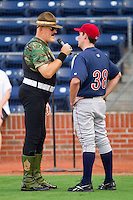 Former WWF star Sergeant Slaughter has a few words with a player prior to the start of the International League game between the Lehigh Valley IronPigs and the Durham Bulls at Durham Bulls Athletic Park June 26, 2010, in Durham, North Carolina.  Photo by Brian Westerholt / Four Seam Images