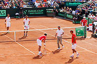 15-09-12, Netherlands, Amsterdam, Tennis, Daviscup Netherlands-Suisse, Doubles, Robin Haase/Jean-Julian Rojer  vs   Roger Federer/Stanislas Wawrinka.(foreground) discusssing a linecall