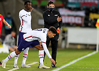 SWANSEA, WALES - NOVEMBER 12: Nicholas Gioacchini #9 and Timothy Weah #23 of the United States wait to enter the field during a game between Wales and USMNT at Liberty Stadium on November 12, 2020 in Swansea, Wales.