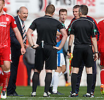 Mark Warburton, Andy Halliday and Jim Stewart confront referee John Beaton on the pitch at full-time