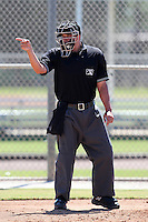 Home plate umpire Doug Delbello during an Instructional League game between the Minnesota Twins and New York Mets at Lee County Sports Complex on October 4, 2011 in Fort Myers, Florida.  (Mike Janes/Four Seam Images)