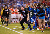 Honduran head coach Luis Fernando Suarez yells to his team during the quarterfinals of the CONCACAF Gold Cup at M&T Bank Stadium in Baltimore, MD.  Honduras defeated Costa Rica, 1-0.