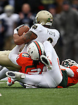 Notre Dame Fighting Irish wide receiver Michael Floyd (3) gets tackled by Miami Hurricanes linebacker Sean Spence (31) during the 2010 Hyundai Sun Bowl football game between the Notre Dame Fighting Irish and the Miami Hurricanes at the Sun Bowl Stadium in El Paso, Tx. Notre Dame defeats Miami 33 to 17...
