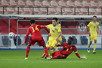 Koni De Winter (14) of Belgium , Arman Kenessov (14) of Kazakhstan and Amadou Onana (6) of Belgium  in action during a soccer game between the national teams Under21 Youth teams of Belgium and Kazakhstan on the third matday in group I for the qualification for the Under 21 EURO 2023 , on friday 8 th of october 2021  in Leuven , Belgium . PHOTO SPORTPIX | SEVIL OKTEM