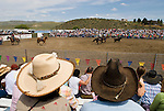 Spectators with western hats watch the team roping at the Jordan Valley Big Loop Rodeo..