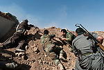 30/09/14  Iraq -- Daquq, Iraq -- Peshmerga fighters shooting with BKC at the front line in Wahda village in Daquq.