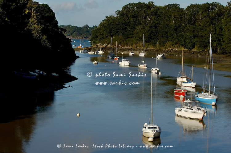 Sailboats floating on the Rance river, Brittany, France.
