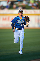 Corpus Christi Hooks center fielder Derek Fisher (22) jogs to the dugout in between innings during a game against the Frisco RoughRiders on April 23, 2016 at Whataburger Field in Corpus Christi, Texas.  Corpus Christi defeated Frisco 3-2.  (Mike Janes/Four Seam Images)