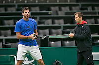 08-02-14, Netherlands,Rotterdam,Ahoy, ABNAMROWTT,, ,  Juan-Martin Del Potro (ARG) has arrived and is warming up with his coach Franco Davín.<br /> Photo:Tennisimages/Henk Koster