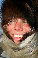 Tuesday March 6, 2007    Rookie Sigrid Ekran from Norway is all smiles despite the sub-zero temperatures and bloodied nose after arriving at the Nikolai checkpoint on Tuesday