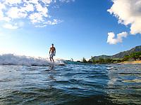 A man surfs near Rest Camp, or Pilila'au Army Recreation Center, in Poka'i Bay, West O'ahu.