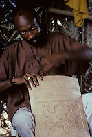 Abidjan, Ivory Coast, Cote d'Ivoire - Tuareg Man, Leatherworker designing top to a leather-covered storage box