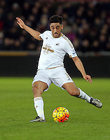 Neil Taylor of Swansea crosses the ball during the Barclays Premier League match between Swansea City and Watford at the Liberty Stadium, Swansea on January 18 2016