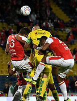 BOGOTA - COLOMBIA, 22-04-2018: José Moya (Izq.) y   Carlos Henao (Der.) jugadores de Independiente Santa Fe, disputan el balón con Felipe Aguirre (Cent.) jugador jugador de Leones F. C., durante partido de la fecha 17 entre Independiente Santa Fe y Leones F. C., por la Liga Aguila I 2018, en el estadio Nemesio Camacho El Campin de la ciudad de Bogota. / Jose Moya (L) and Carlos Henao (R) players of Independiente Santa Fe struggle for the ball with Felipe Aguirre (C) player of Leones F. C., during a match of the 17th date between Independiente Santa Fe and Leones F. C., for the Liga Aguila I 2018 at the Nemesio Camacho El Campin Stadium in Bogota city, Photo: VizzorImage / Luis Ramirez / Staff.