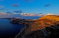 A spectacular sunset over the cliffs at Santorini, Greece