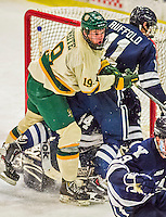 4 January 2014:  University of Vermont Catamount Forward Matt White, a Senior from McMurray, PA, checks Yale University Bulldog forward Trent Ruffolo, a Junior from Coral Springs, FL, in the third period at Gutterson Fieldhouse in Burlington, Vermont. With an empty net and seconds remaining, the Cats came back to tie the game 3-3 against the 10th seeded Bulldogs. Mandatory Credit: Ed Wolfstein Photo *** RAW (NEF) Image File Available ***