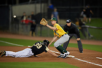 Siena Saints first baseman Eddie Sweeney (20) waits for a pickoff attempt throw as Connor Allen (39) dives back to the bag during a game against the UCF Knights on February 14, 2020 at John Euliano Park in Orlando, Florida.  UCF defeated Siena 2-1.  (Mike Janes/Four Seam Images)