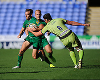 Andrew Fenby of London Irish forces his way past Calum Clark of Northampton Saints during the Premiership Rugby match between London Irish and Northampton Saints at the Madejski Stadium on Saturday 4th October 2014 (Photo by Rob Munro)