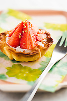 Detail of a homemade strawberry and caramel tart