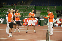 7-2-06, Netherlands, Amsterdam, Daviscup, first round, Netherlands-Russia, training Coach Tjerk Bogtstra (r) and John van Lottum eveluate