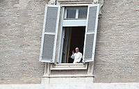 Pope Francis delivers his blessing at the window of the Apostolic palace on April 13, 2020 in the Vatican, after delivering his message during a private Angelus prayer live broadcast from the palace's library on Easter Monday, during the lockdown aimed at curbing the spread of the COVID-19 infection, caused by the novel coronavirus.<br /> UPDATE IMAGES PRESS/Isabella Bonotto<br /> <br /> STRICTLY ONLY FOR EDITORIAL USE
