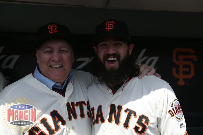 """SAN FRANCISCO, CA - APRIL 8:  John """"The Count"""" Montefusco and Cory Gearrin #26 of the San Francisco Giants pose for a picture in the dugout waiting before the game against the Los Angeles Dodgers at AT&T Park on Sunday, April 8, 2018 in San Francisco, California. (Photo by Brad Mangin)"""