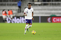 ORLANDO CITY, FL - JANUARY 31: Andres Perea #8 of the United States dribbles with the ball during a game between Trinidad and Tobago and USMNT at Exploria stadium on January 31, 2021 in Orlando City, Florida.
