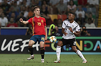 Spain's Dani Olmo, left, is challenged by Germany's Benjamin Heinrichs during the Uefa Under 21 Championship 2019 football final match between Spain and Germany at Udine's Friuli stadium, Italy, June 30, 2019. Spain won 2-1.<br /> UPDATE IMAGES PRESS/Isabella Bonotto