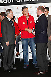 Real Madrid player Mesut Ozil (c) and the President Florentino Perez participate and receive new Audi during the presentation of Real Madrid's new cars made by Audi at the Jarama racetrack on November 8, 2012 in Madrid, Spain.(ALTERPHOTOS/Harry S. Stamper)