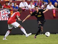 Ashley Young (18) of Manchester United defends Cuenca (29) of Barcelona during the friendly at FedEX Field in Landover, MD.  Manchester United defeated FC Barcelona, 2-1.