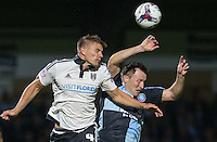 Shaun Hutchinson of Fulham  beats Garry Thompson of Wycombe Wanderers to the ball in the air during the Capital One Cup match between Wycombe Wanderers and Fulham at Adams Park, High Wycombe, England on 11 August 2015. Photo by Andy Rowland.