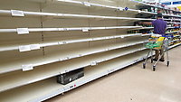 Pictured: Empty shelves at the pasta section of the Tesco super market in Swansea, Wales, UK. Sunday 22 March 2020<br /> Re: Covid-19 Coronavirus pandemic, UK.
