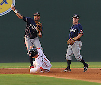 A sliding Blake Swihart (10) of the Greenville Drive takes out infielder Fernando De Los Santos (1) of the Rome Braves but can't prevent a double play in the second inning of a game against the Greenville Drive on August 15, 2012, at Fluor Field at the West End in Greenville, South Carolina. Rome won, 6-1. (Tom Priddy/Four Seam Images)
