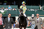 """LEXINGTON, KY - OCTOBER 12: #2 La Coronel and jockey Florent Geroux entering the winner's circle after winning the 26th running of the JPMorgan Chase Jessamine (Grade 3) $150,000 """"Win and You're In Juvenile Fillies Turf Division"""" for owner John Oxley and trainer Mark Casse at Keeneland Race Course.  October 12, 2016, Lexington, Kentucky. (Photo by Candice Chavez/Eclipse Sportswire/Getty Images)"""